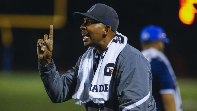 San Diego head coach Charles James gives direction to his players during a timeout in the third quarter against Kearny.