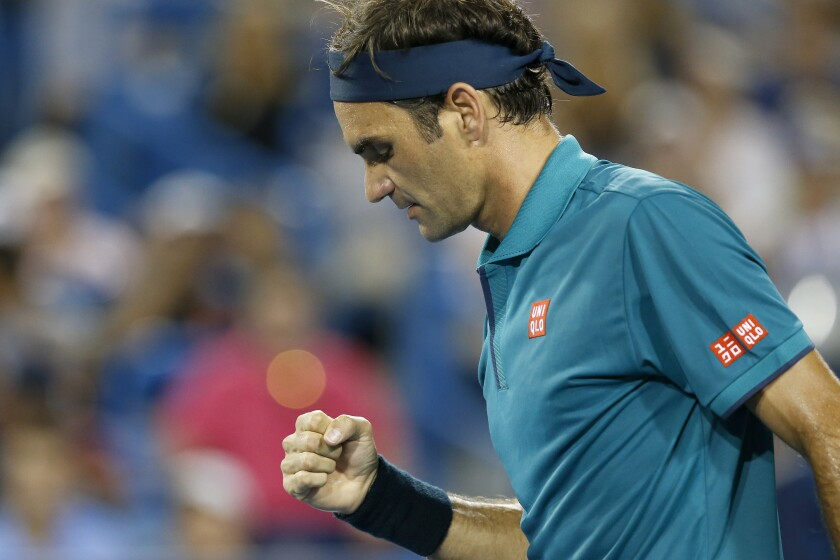 Roger Federer pumps his fist after match point in the second set against Juan Ignacio Londero at the Western & Southern Open tennis tournament in Mason, Ohio, Tuesday, Aug. 13, 2019. (Sam Greene/The Cincinnati Enquirer via AP)