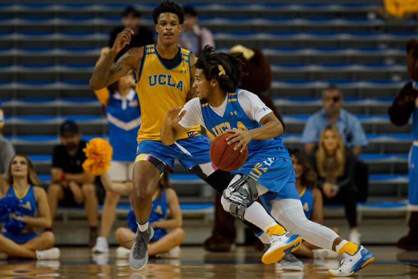 UCLA's Tyger Campbell (1) drives to the basket during a preseason showcase at Pauley Pavillion on Oct. 23.
