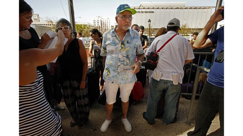 Luis Frankie, 66, waits to board an evacuation cruise ship in San Juan.