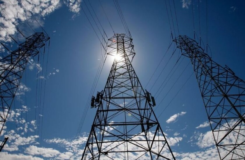 The sun shines through towers carrying electrical lines in California in this 2007 file photo.