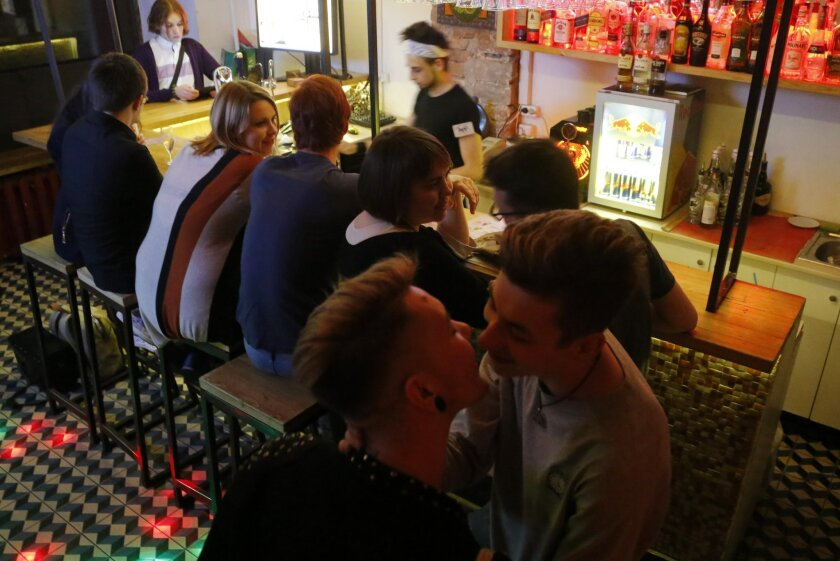 In this Friday, May 27, 2016 photo, visitors relax in a gay nightclub in St. Petersburg, Russia. Russian crime gangs find gays easy targets for blackmail. In the past two years, an increasing number of gays has fallen victim to criminal gangs operating through gay dating sites, rights groups say. (