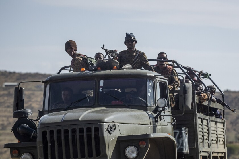"""FILE - In this Saturday, May 8, 2021 file photo, Ethiopian government soldiers ride in the back of a truck on a road near Agula, north of Mekele, in the Tigray region of northern Ethiopia. Tigray forces say Ethiopia's government has launched its threatened major military offensive against them in an attempt to end a nearly year-old war. A statement from the Tigray external affairs office on Monday, Oct. 11 alleged that hundreds of thousands of Ethiopian """"regular and irregular fighters"""" launched a coordinated assault on several fronts. (AP Photo/Ben Curtis, File)"""