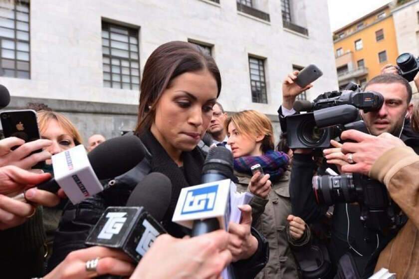Former exotic dancer Karima El Mahroug, who was nicknamed Ruby Heart-Stealer, made a tearful statement Thursday outside the Italian courthouse where former Prime Minister Silvio Berlusconi is due to be tried on charges of paying for sex with her when she was still a minor.