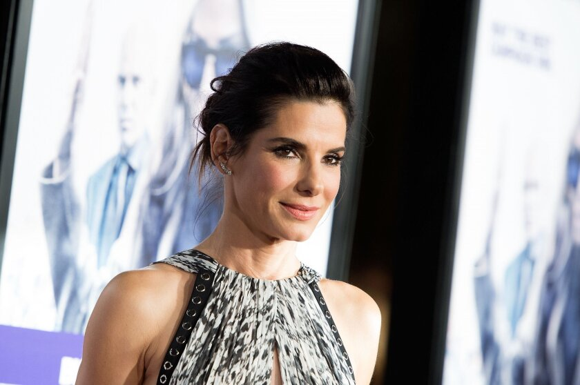"""Sandra Bullock, photographed here at the """"Our Brand is Crisis"""" premiere in Hollywood on Oct. 26, has adopted a daughter."""