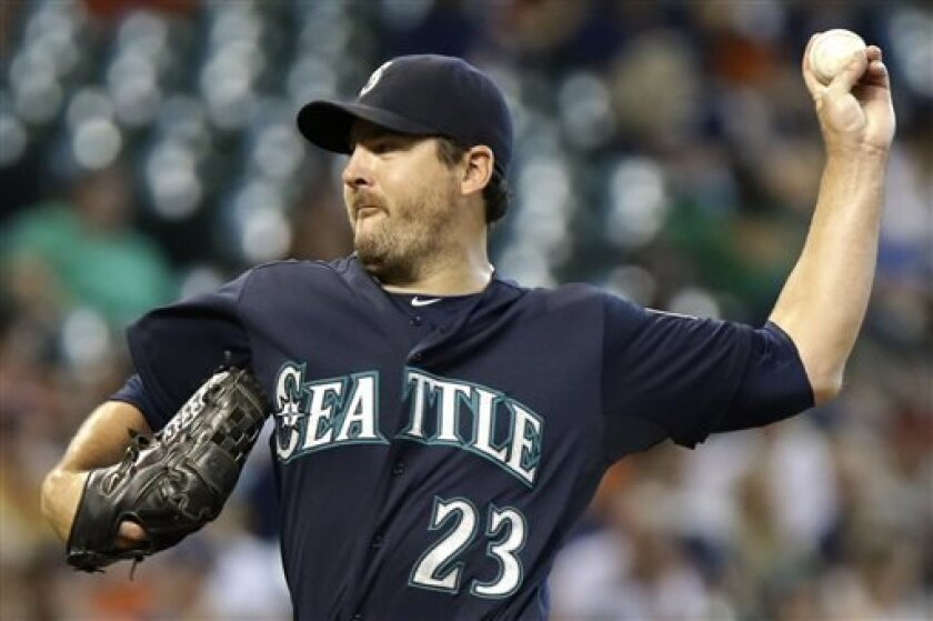 Seattle Mariners' Joe Saunders delivers a pitch against the Houston Astros in the first inning of a baseball game Saturday, Aug. 31, 2013, in Houston. (AP Photo/Pat Sullivan)