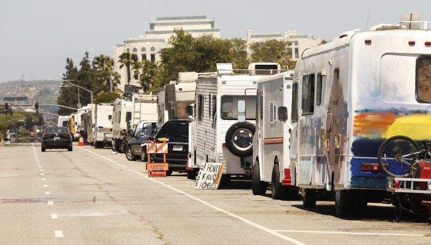 Campers are parked along West Jefferson Boulevard in Los Angeles.
