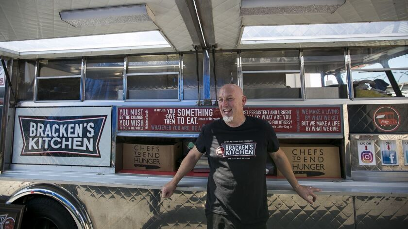 Bill Bracken, the founder of Bracken's Kitchen, uses a food truck to provide heatly meals to
