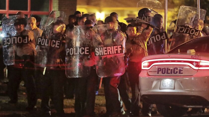 Shelby County Sheriffs Deputies brace against the crowd as protesters take to the streets of Frayser