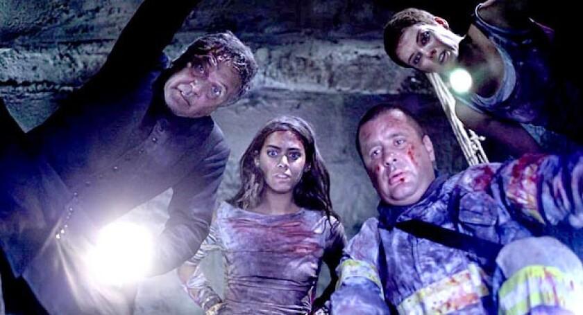 "Patricio Strahovsky, Lorenza Izzo, Marcial Tangle, and Andrea Osvart in ""Aftershock."""