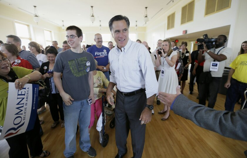 "FILE - In this May 30, 2014, file photo, former Republican presidential nominee Mitt Romney greets supporters before speaking at a rally for Iowa Republican Senate candidate Joni Ernst in Cedar Rapids, Iowa. He feared he would be ""a loser for life"" if he failed to win the presidency, but Romney is trying to re-emerge as a force in Republican politics. (AP Photo/Charlie Neibergall, File)"