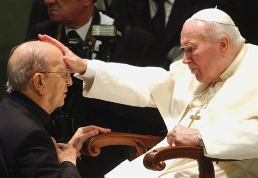 FILE - In this Nov. 30, 2004 file photo, Pope John Paul II gives his blessing to father Marcial Maciel, founder of the Legion of Christ, during a special audience at the Vatican. Pope Benedict XVI took over the Legion in 2010 after a Vatican investigation determined that Maciel had sexually moleste