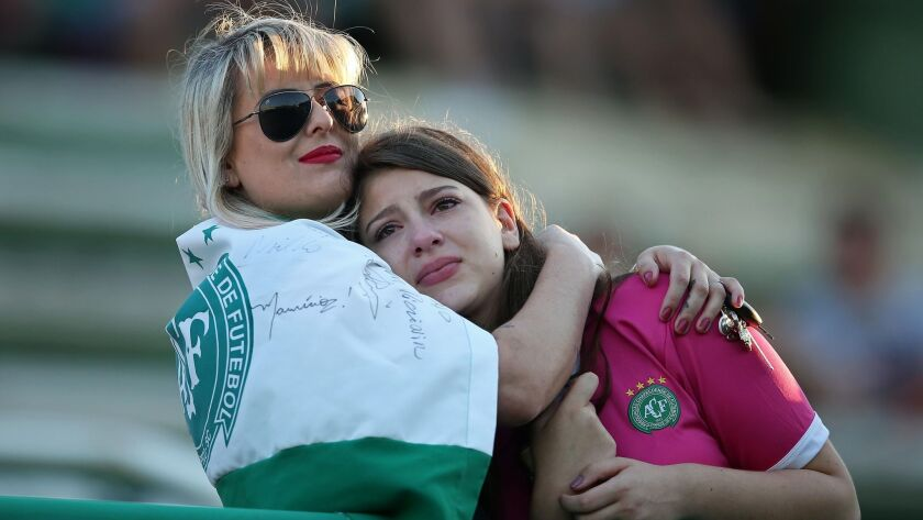 Fans pay tribute to the players of Brazilian team Chapecoense Real who were killed in a plane accident in the Colombian mountains on Nov. 29.