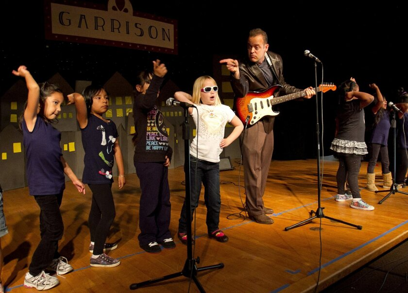 Garrison Elementary School student jazz band performs classic jazz songs with music teacher Jon Schwartz on Tuesday in the school's cafeteria.