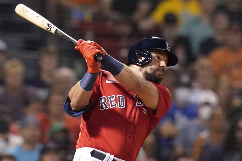 Boston Red Sox's Kyle Schwarber watches his lineout in the fifth inning of the team's baseball game against the Baltimore Orioles at Fenway Park, Friday, Aug. 13, 2021, in Boston. (AP Photo/Elise Amendola)