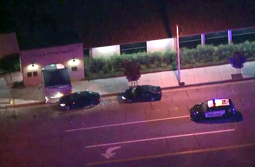 Authorities respond to a shooting outside the La Habra Police Department.