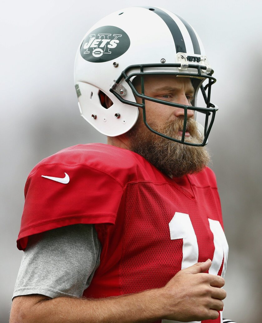 New York Jets quarterback Ryan Fitzpatrick runs to the sidelines during practice at the team's NFL football training facility, Wednesday, Nov. 18, 2015, in Florham Park, N.J. Fitzpatrick returned from surgery to repair a torn ligament in his left thumb. (AP Photo/Rich Schultz)