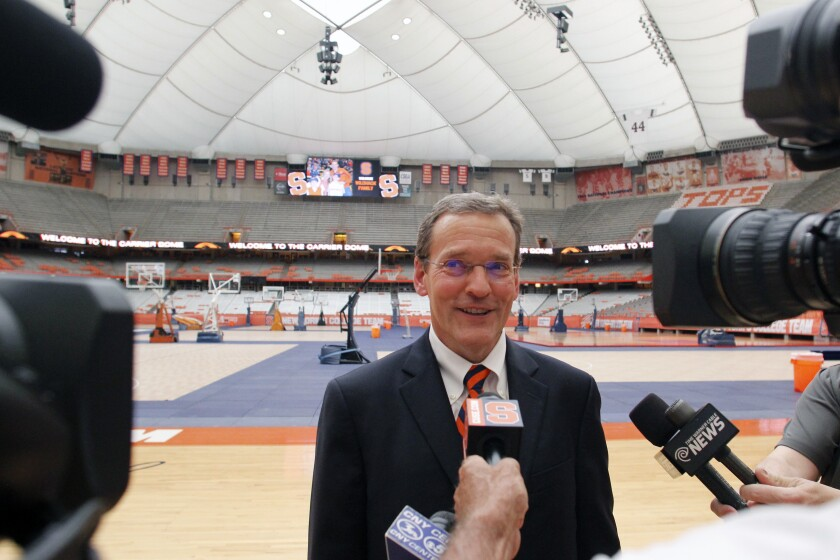 FILE - Syracuse University athletic director John Wildhack talks to the media during a visit to the Carrier Dome in Syracuse, N.Y., in this Tuesday, July 12, 2016, file photo. In the dead of winter Syracuse athletic director John Wildhack was brainstorming about the future and how to make some sort of social impact through sports. Wildhack floated the idea of an alliance with the MEAC, a group of historically black colleges and universities in the southeastern and mid-Atlantic regions of the country, that would include athletic competition, seminars on athletic compliance and fundraising, visiting professorships, and an internship exchange. (AP Photo/Nick Lisi, File)