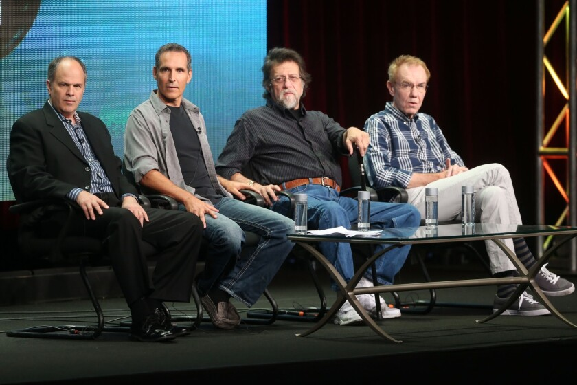 Executive producer Michael Kantor, from left, and comic book writers Todd McFarlane, Len Wein and Gerry Conway talk about the PBS docu-series 'Superheroes: A Never-Ending Battle' at the Summer Television Critics Assn. tour at the Beverly Hilton Hotel on Aug. 7 in Beverly Hills.