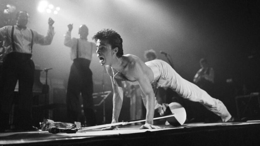 Prince performs on stage on the Hit N Run-Parade Tour at Wembley Arena in London in August 1986.