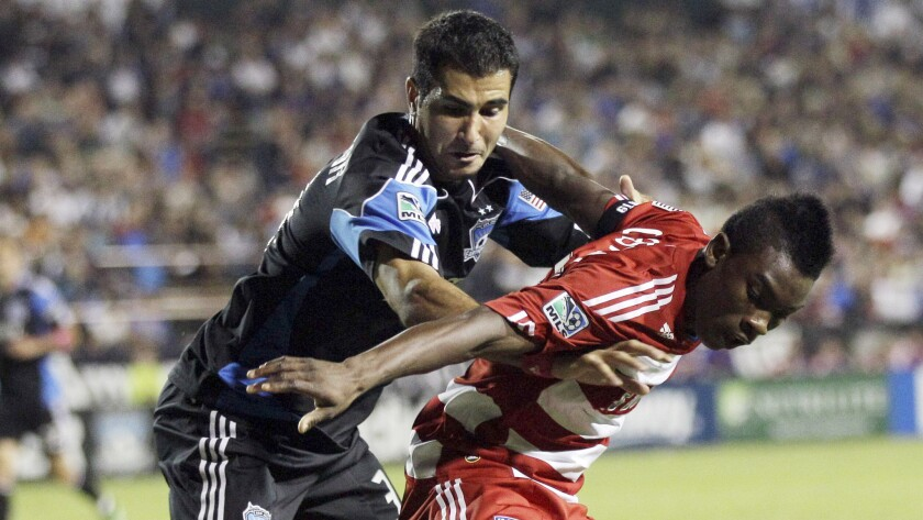 San Jose defender Steven Beitashour, left, battles for the ball with FC Dallas forward Fabian Castillo during a 2011 match. Beitashour hopes to be playing for Iran in next month's World Cup.