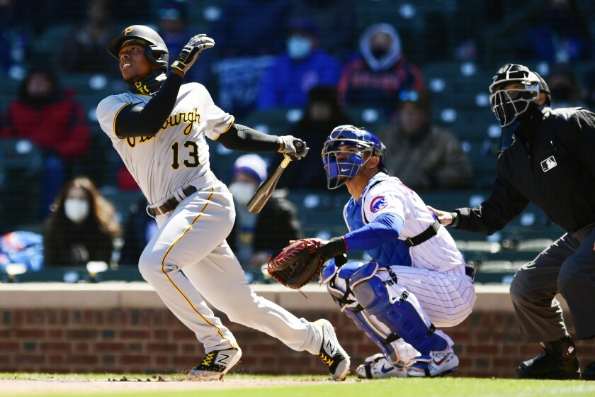 Pittsburgh Pirates' Ke'Bryan Hayes (13) watches his two-run home run during the first inning of a baseball game against the Chicago Cubs Thursday, April 1, 2021, on opening day at Wrigley Field in Chicago. (AP Photo/Paul Beaty)