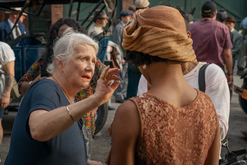 """Costume designer Ann Roth works with Taylour Paige on the set of """"Ma Rainey's Black Bottom."""""""