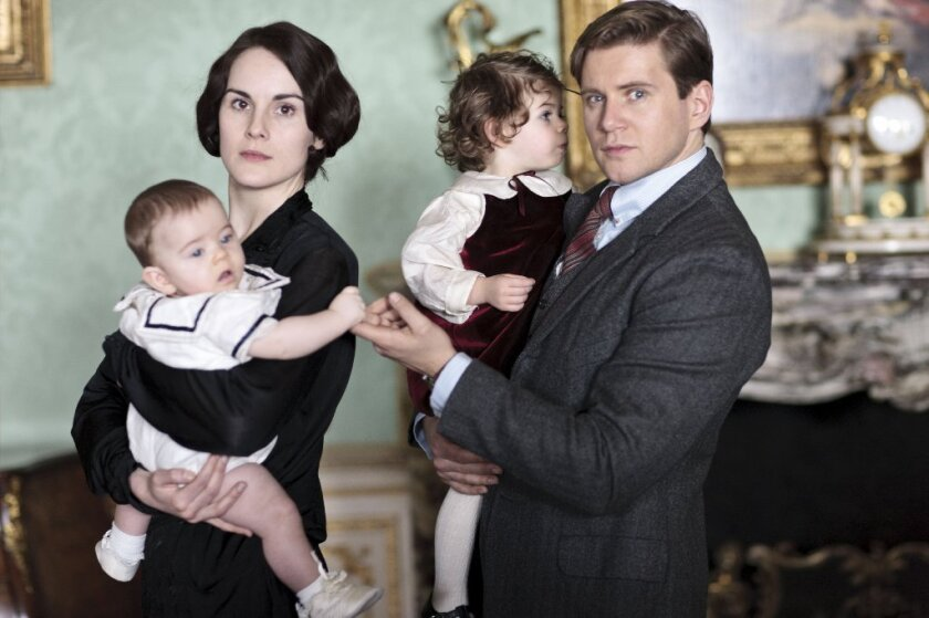 """Lady Mary of the TV series """"Downton Abbey,"""" played by actress Michelle Dockery, will start the upcoming season as a widow. Pictured next to Dockery's character is actor Allen Leech's character Tom Branson."""