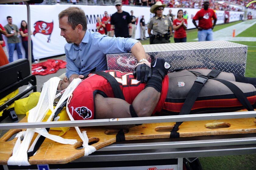 Tampa Bay Buccaneers  linebacker Quincy Black (58) gives a thumbs-up to the crowd as he leaves the field after being injured in a collision with San Diego Chargers running back Ryan Mathews.