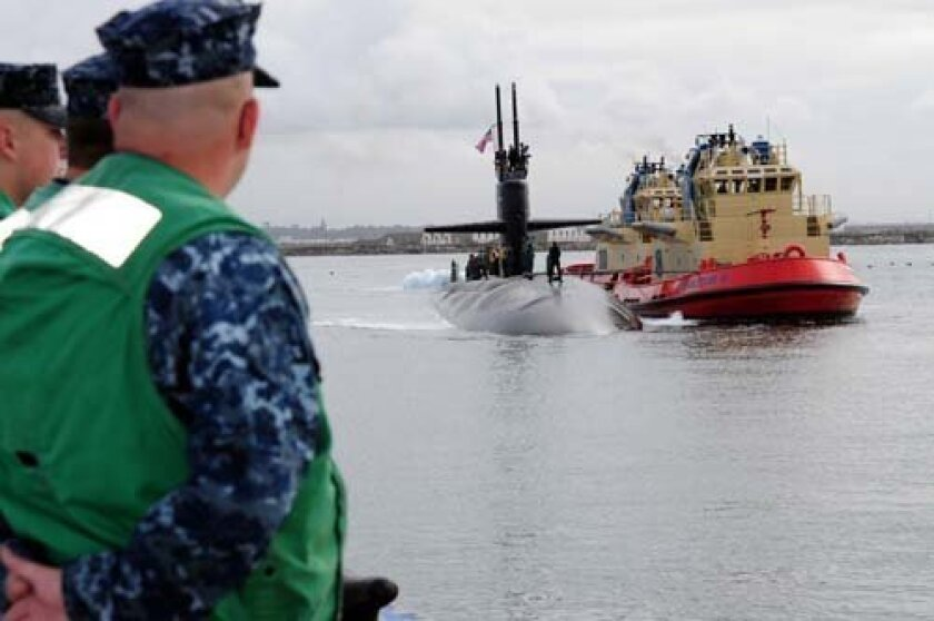 Line handlers prepare to tie Los Angeles-class, fast-attack submarine USS La Jolla (SSN 701) to the pier at Naval Base Point Loma.  USS La Jolla is in San Diego making a namesake port visit to the township of La Jolla, Calif.  While in San Diego, La Jolla Sailors are scheduled to participate in sev