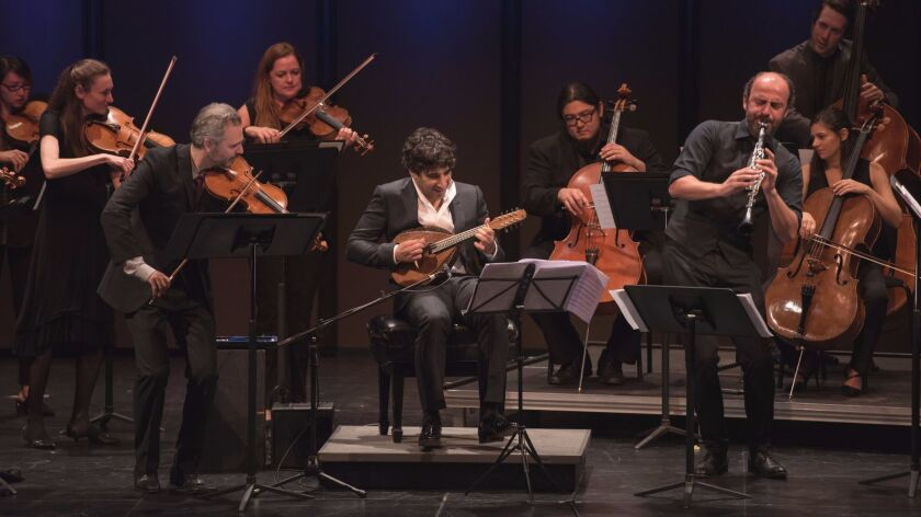 Violinist Colin Jacobsen, mandolinist Avi Avital and clarinetist Kinan Azmeh perform with the Knights at the Broad Stage on Wednesday.