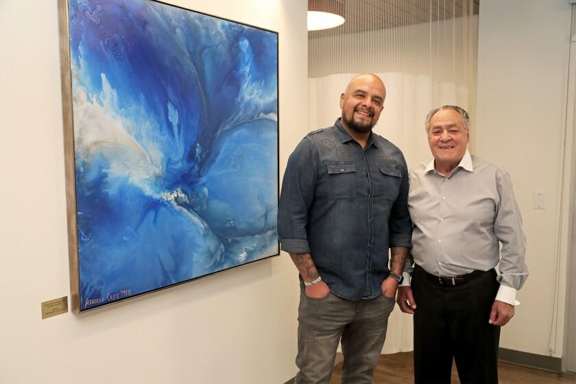 Cancer survivor Frank Di Bella and abstract artist Leonardo Cruz Melo.