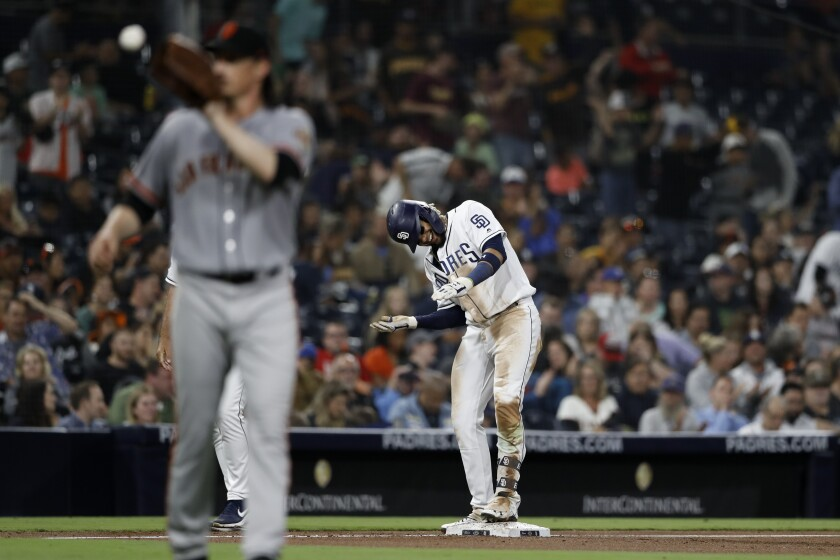The Padres' Fernando Tatis Jr. reacts after hitting a triple as San Francisco Giants starting pitcher Jeff Samardzija, left, catches the ball during the sixth inning of Monday's game at Petco Park.