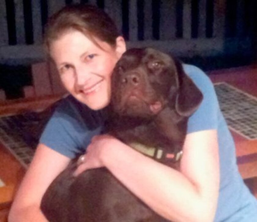 Dr. Julie Breher of of La Jolla Veterinary Hospital with her dog, Clyde. (Courtesy Photo)