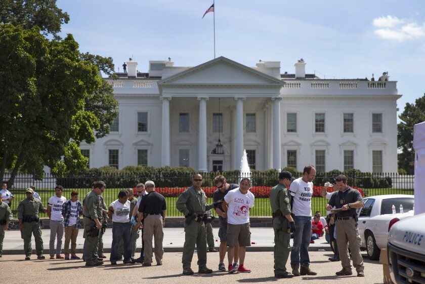 Immigration reform protesters arrested outside the White House after President Obama delayed announcing executive actions on immigration enforcement.