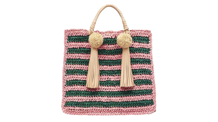The packable rainbow raffia Straw Travel Tote from Loeffler Randall has removable pom-pom tassels an