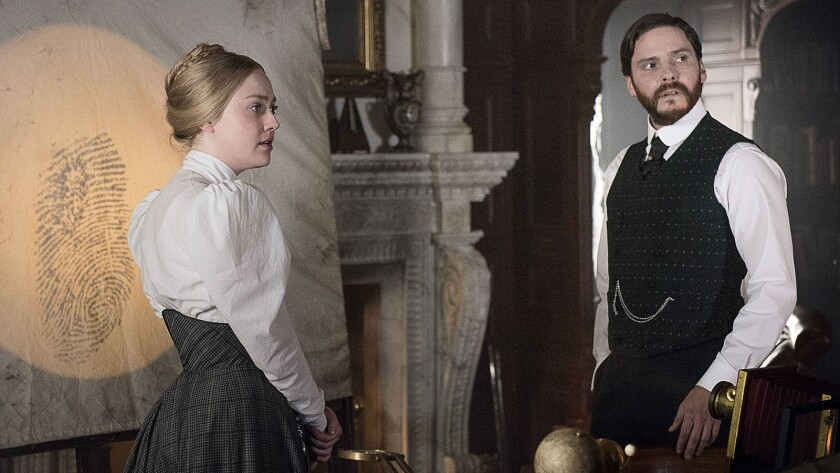 "Dakota Fanning and Daniel Brühl in a new episode of the period crime drama ""The Alienist"" on TNT."