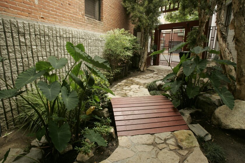 <p>  Waterfalls and a garden lead to the Chinese Historical Museum. It originally was a Chinese Mission and was moved to its current home on Third Avenue and J Street in 1996.  <em>   Laura Embry / U-T  </em> </p>