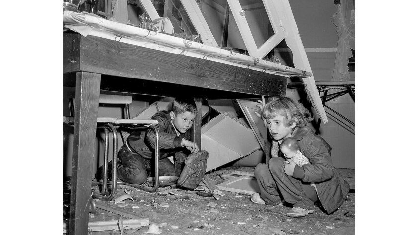 Feb. 1, 1957: Randy Kuehl, 8, left, retrieves baseball glove and Linda Sue Knight, 5, her doll from