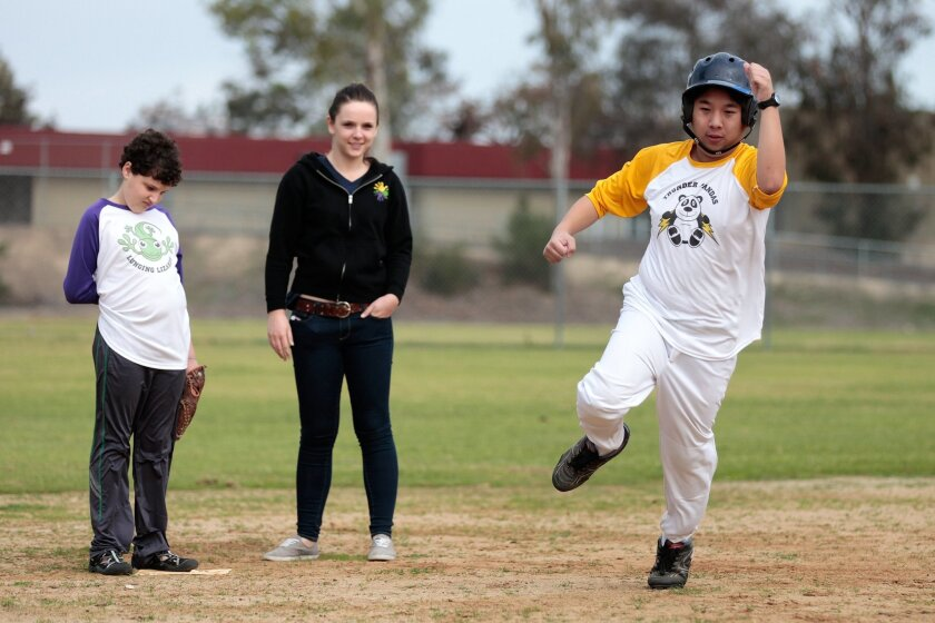 Brandon Quy, 21, rounds third base during an adapted baseball game for youth with autism in Rancho Penasquitos Saturday.