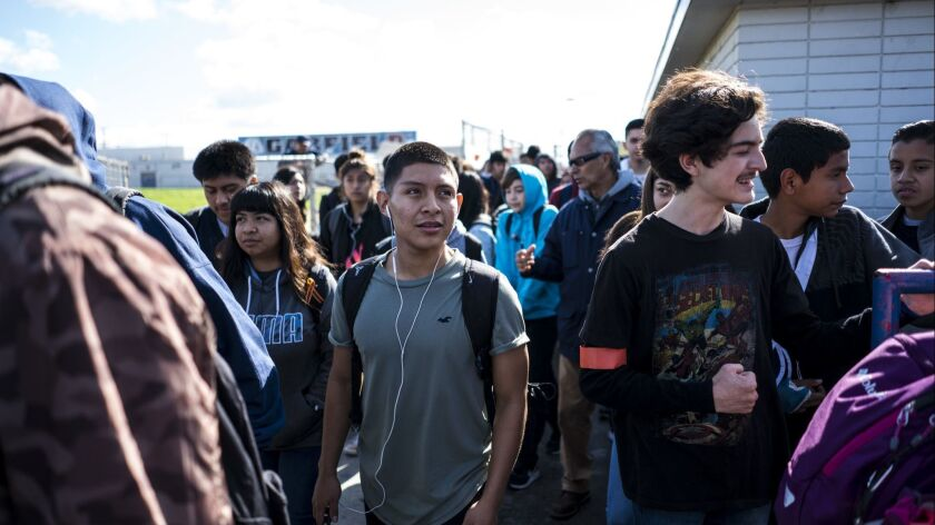 LOS ANGELES, CA - MARCH 14: Students at Garfield High School participate in a student organized walk