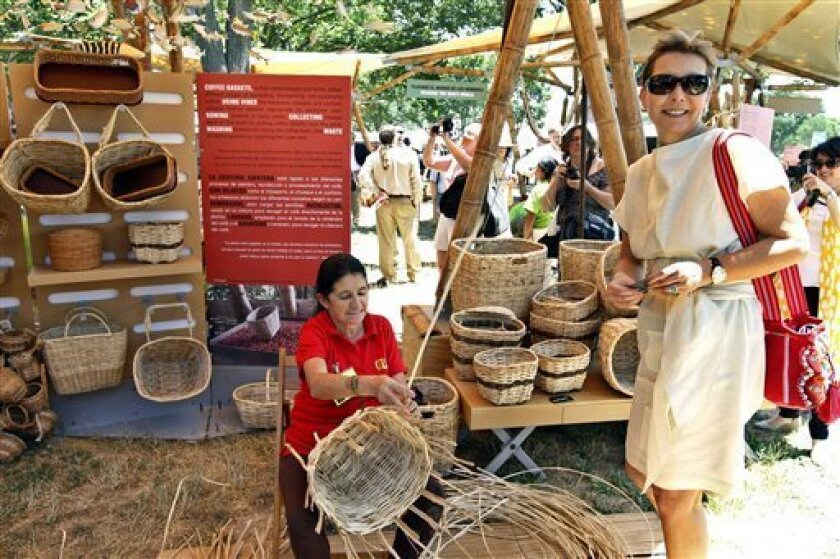 Colombia's first lady Maria Clemencia de Santos tours the Colombian exhibit during the opening of the Smithsonian's Folklife Festival 2011, Thursday, June 30, 2011, on the National Mall in Washington. (AP Photo/Jose Luis Magana)