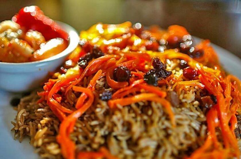 A signature entree at Chili Chutney in Lake Forest: quabuli pallow, a basmati fried rice cooked with lamb and spices garnished with carrots and raisins.