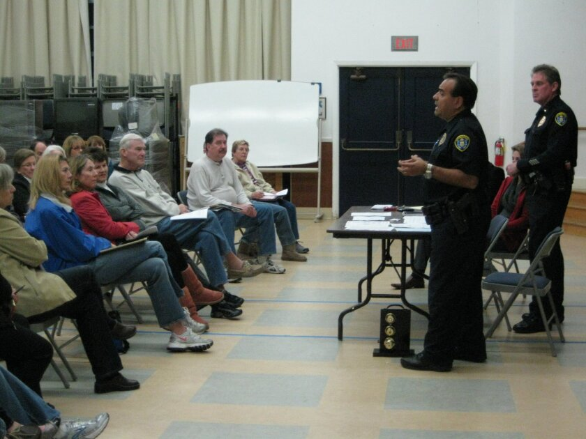 Police officers present their residential burglary findings to Bird Rock residents at a special meeting last week.