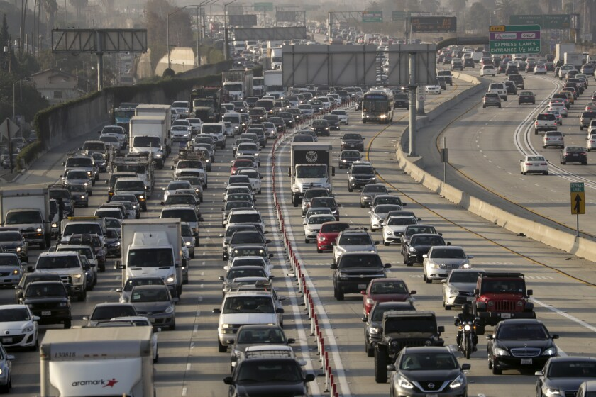 A packed L.A. freeway, full of cars, trucks and other vehicles