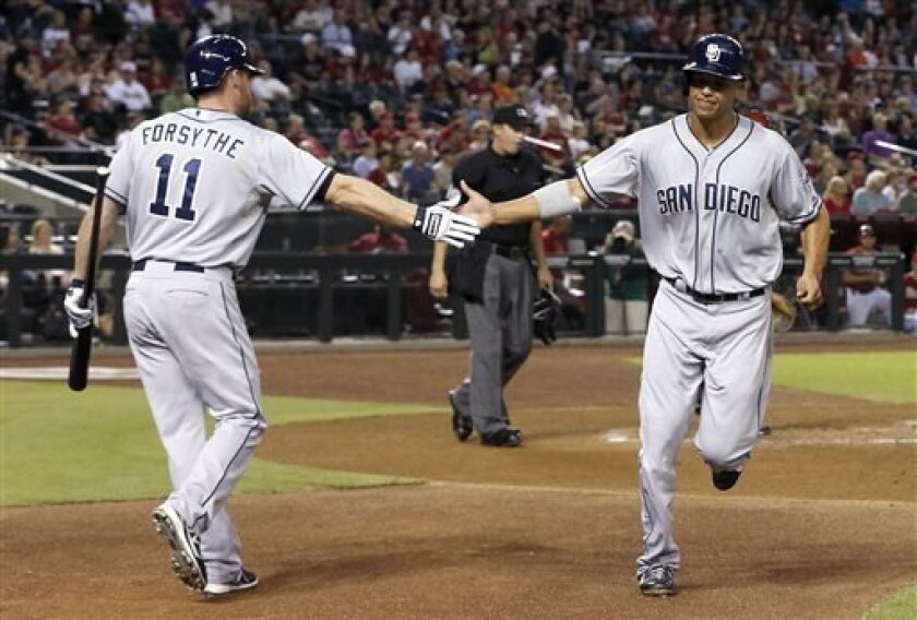 San Diego Padres' Will Venable, right, shakes hands with teammate Logan Forsythe (11) after scoring a run against the Arizona Diamondbacks in the first inning during a baseball game on Wednesday, Aug. 28, 2013, in Phoenix. (AP Photo/Ross D. Franklin)