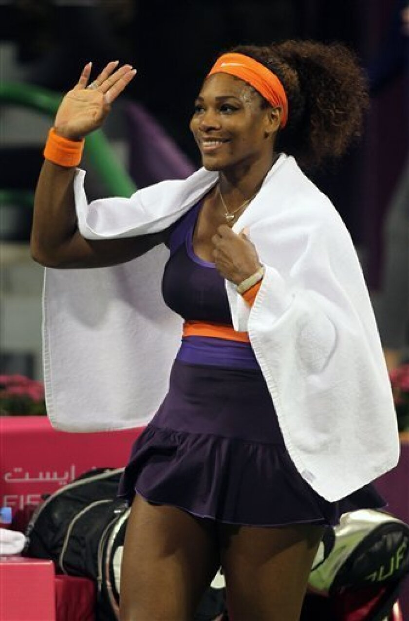 Serena Williams of the U.S. celebrates winning her singles match against Daria Gavrilova of Russia during the second day of the WTA Qatar Ladies Open in Doha, Qatar, Tuesday, Feb. 12, 2013. (AP Photo/Osama Faisal)