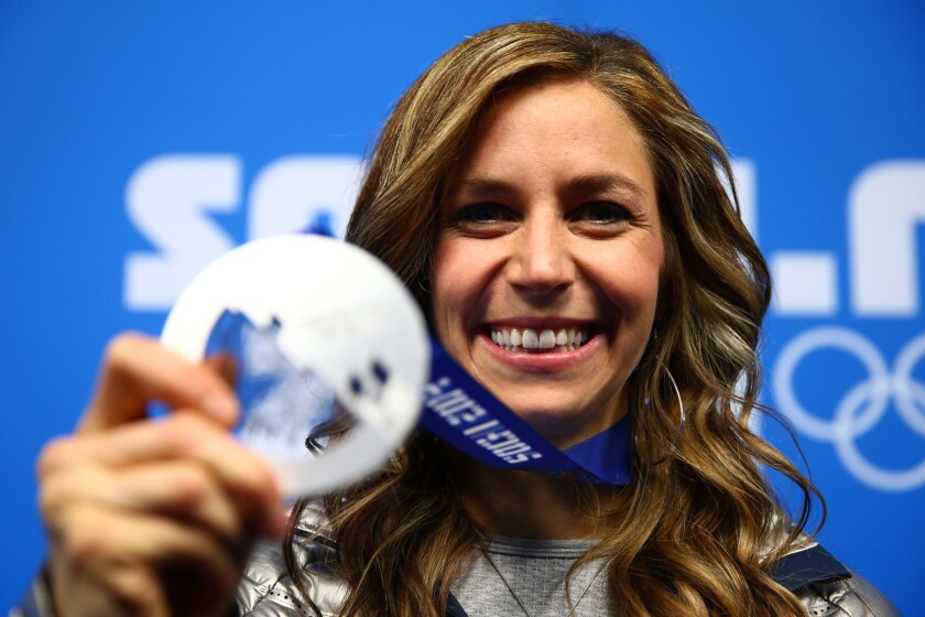U.S. silver medalist Noelle Pikus-Pace celebrates during the medal ceremony for the Women's skeleton on Saturday, Day 8 of the Sochi 2014 Winter Olympics at Medals Plaza.