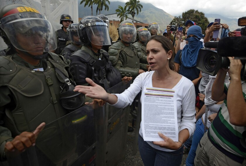 Venezuelan opposition leader Maria Corina Machado talks to members of the national guard during a protest against President Nicolas Maduro in Caracas on March 16, 2014.