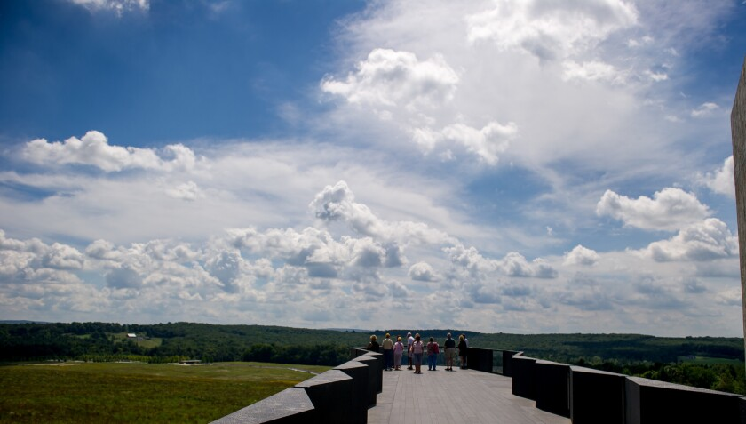 Visitors at the Flight 93 National Memorial look over the flight path of the plane that crashed on Sept. 11, 2001.